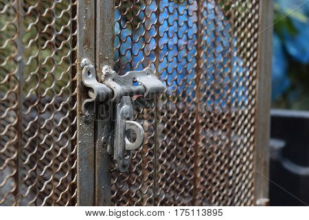 Close up of a large animal cage on the car and strong material , The door closed.