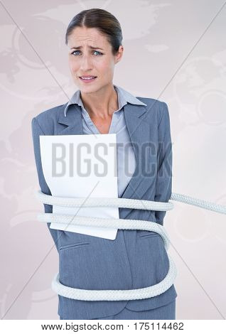 Portrait of businesswoman tied up with rope and paper against white background