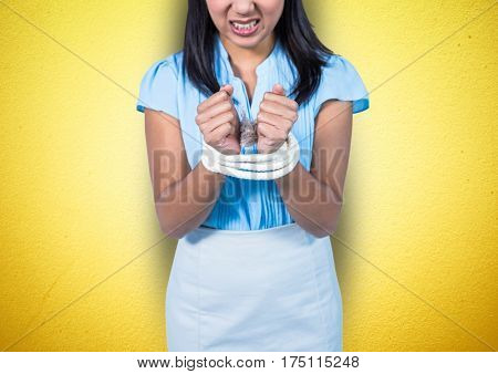 Mid section of angry businesswoman being tied up with rope against yellow background