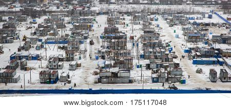 District of temporary housing from containers with workers at the construction site
