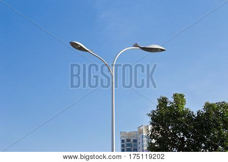 Modern Led street light lamp on the background of blue sky