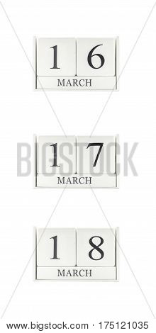 Closeup group of white wooden calendar with black 16 17 18 march word three date calendar isolated on white background