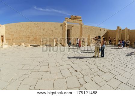 Luxor Egypt - November 13. 2006: Tourists visit the inside of mortuary temple of Hatshepsut in Egypt near The Valley Of The Kings
