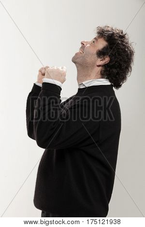 Portrait of adult man with curly hair and black sweater, side view