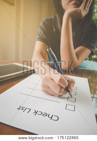 Working Woman Holding Pen And Teblet On Check List Paper And Keeping Hand On Chinin The Stressful Fe