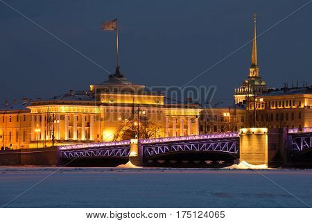 Palace Bridge and Admiralty in night illumination in the February evening. Winter St. Petersburg Russia