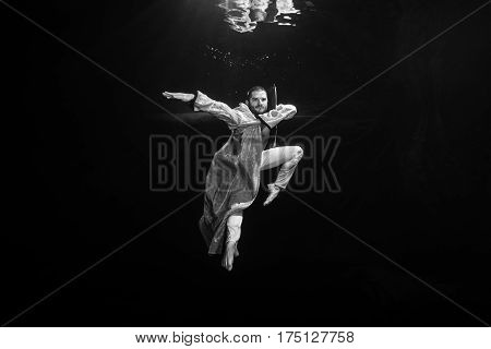 A Young Male Ballet Dancer Posing Underwater