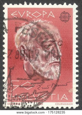 MOSCOW RUSSIA - CIRCA FEBRUARY 2017: a post stamp printed in SWITZERLAND shows a portrait of Ernest Ansermet (1883-1969) a conductor the series