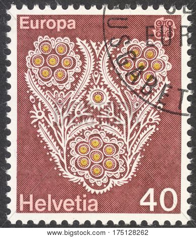 MOSCOW RUSSIA - CIRCA FEBRUARY 2017: a post stamp printed in SWITZERLAND shows Flower pattern of a cotton embroidery the series