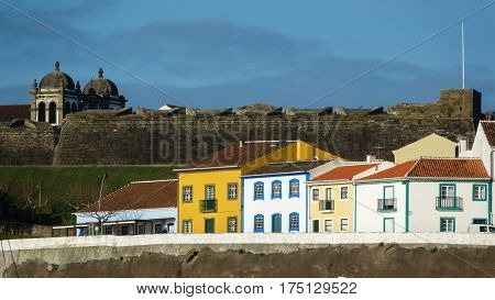 Long shot of colorful houses and fort in the city Angra do Heroismo, Terceira island, Azores islands. Good for postcards