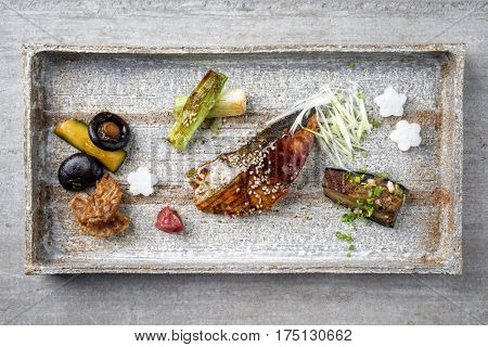 Traditional Japanese dish with Fish Teriyaki and Vegetable as close-up on a tray
