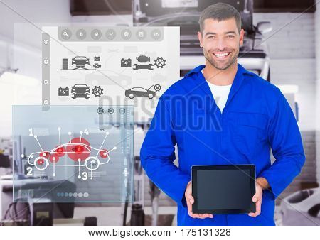 Digital composition of a confident automobile mechanic holding digital tablet and mechanic interface in background
