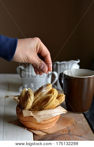 Churros Accompanied Of A Cup Of Chocolate Hot