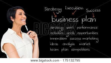 Digital composition of smiling businesswoman holding pen and standing against blackboard with business terms