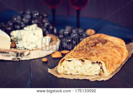 Strudel with cheese and pear. Snack cake strudel. Rural rustic style.