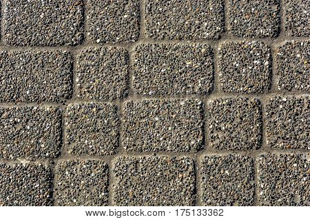 Paving slabs of different sizes from a conglomerate