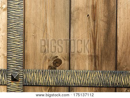 Background wrought-iron fence with old wooden planks