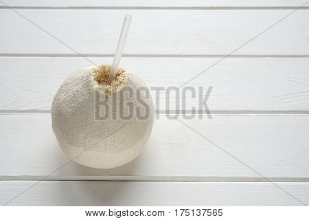coconut fruit with drinking straw to drink fresh coconut water