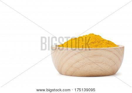 Turmeric Powder In Wooden Bowl