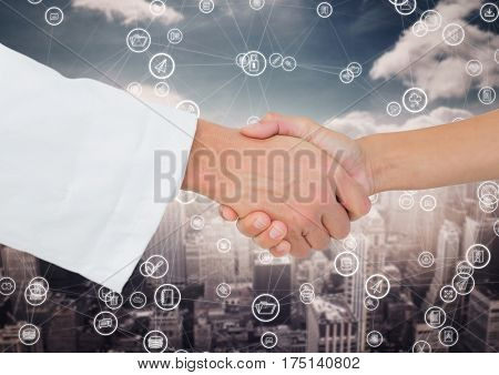 Close-up of businessman and woman shaking hands with each other against digitally generated background