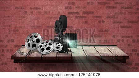 Digitally generated image of film projector with reel placed on table against red bricked wall