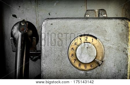 Old street payphone. Disk phone close up