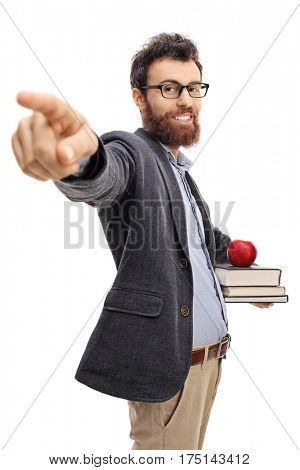 Young teacher pointing at the camera isolated on white background