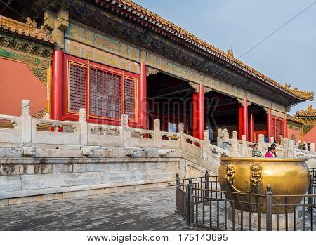Beijing, China - Oct 30, 2016: Entrance to the Gate of Heavenly Purity, or Celestial Purity (Qianqingmen). Forbidden City (Gu Gong, Palace Museum). Note huge bronze water urn in foreground.