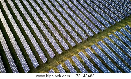 High angle view of solar panels on an energy farm in rural england; full frame background texture.
