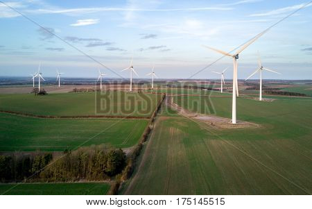High angle aerial view of windmills in a modern wind farm in rural Cambridgeshire England.
