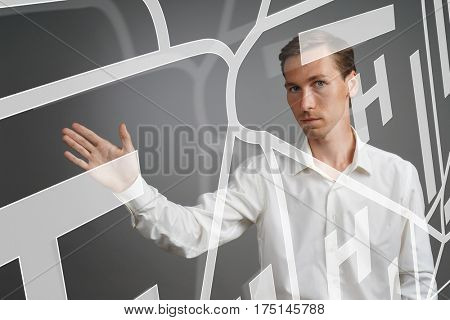 Future technology, navigation, location concept. Man showing transparent screen with gps navigator map.