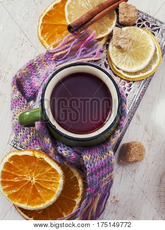Up Of Hot Tea With Lemon And Scarf. Winter Time.