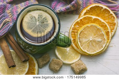 Up Of Hot Tea With Lemon And Scarf. Winter Time