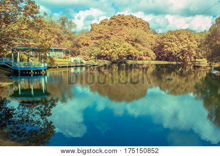 Infrared landscape with calm lake and refection of lake.View in infrared photography,soft focusing.