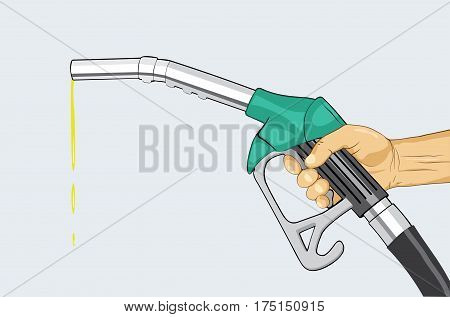 Hand holding fuel nozzle on petrol gas station