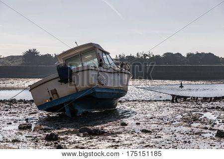 Boat at low tide in the Saint-Gilles Croix de Vie harbour (France)
