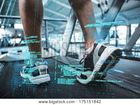 Fit man exercising on treadmill in the gym with fitness interface in background