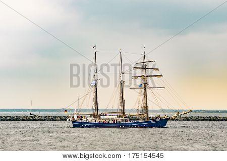 Rostock, Germany - August 2016: Sailing ship Santa Barbara Anna on the sea. Yachting and Sailing travel. Cruises and holidays