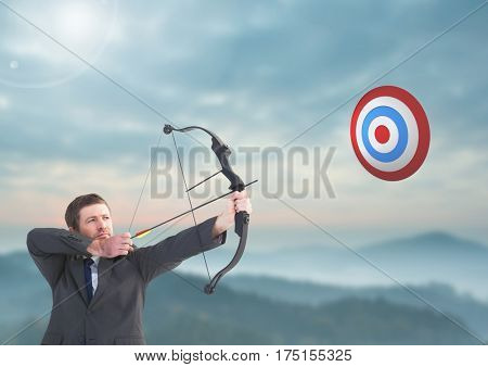 Digital composition of businessman aiming at target with bow and arrow against sky