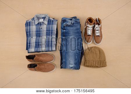 Men's casual outfits with accessories on wooden background
