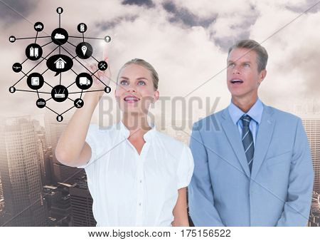 Digital composition of businesspeople using digital screen with digitally generated icon