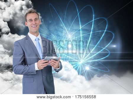 Portrait of businessman holding digital tablet against digitally generated background