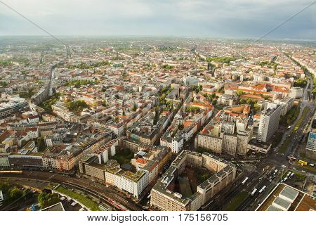 Travel to Germany.  Landmark view of the houses and streets of Berlin with a bird's-eye view. Overcast sky. Light from the sun on the houses. Residential houses landmark. Megapolis. European city landmark