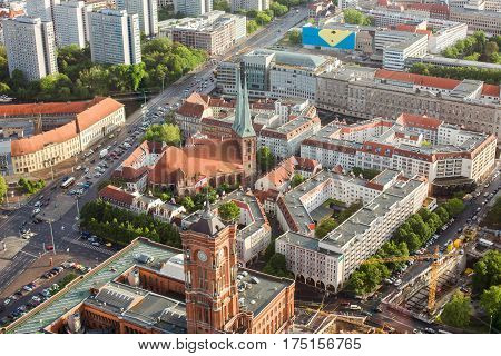 Travel to Germany. View of the houses and streets of Berlin with a bird's-eye view. Overcast sky. Light from the sun on the houses. Residential houses. Berlin Megapolis. European city