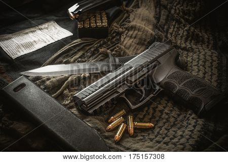 pistol with and combat knife on fabric