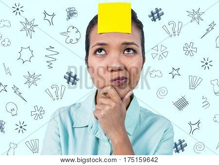 Thoughtful woman with sticky note on her forehead against various doodles in background