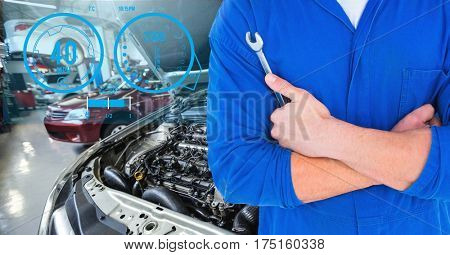 Digital generated image of mechanic holding lug wrench in car repair garage