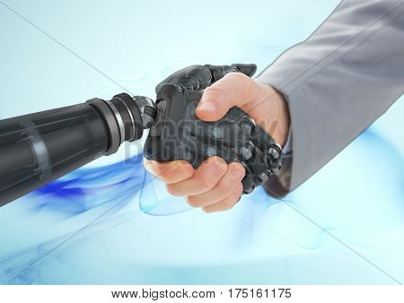 Business man shaking hands with robot against blue background