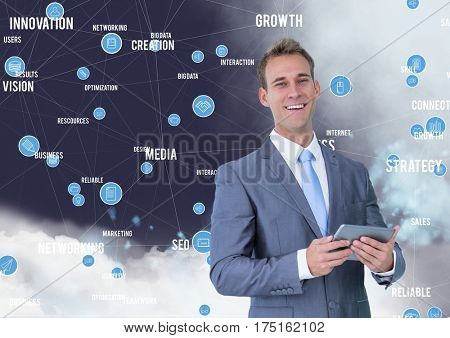 Digital generated image of businessman holding digital tablet with connecting icons
