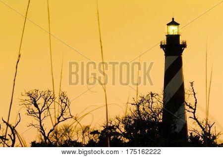 The Cape Hatteras lighthouse illuminated at dusk